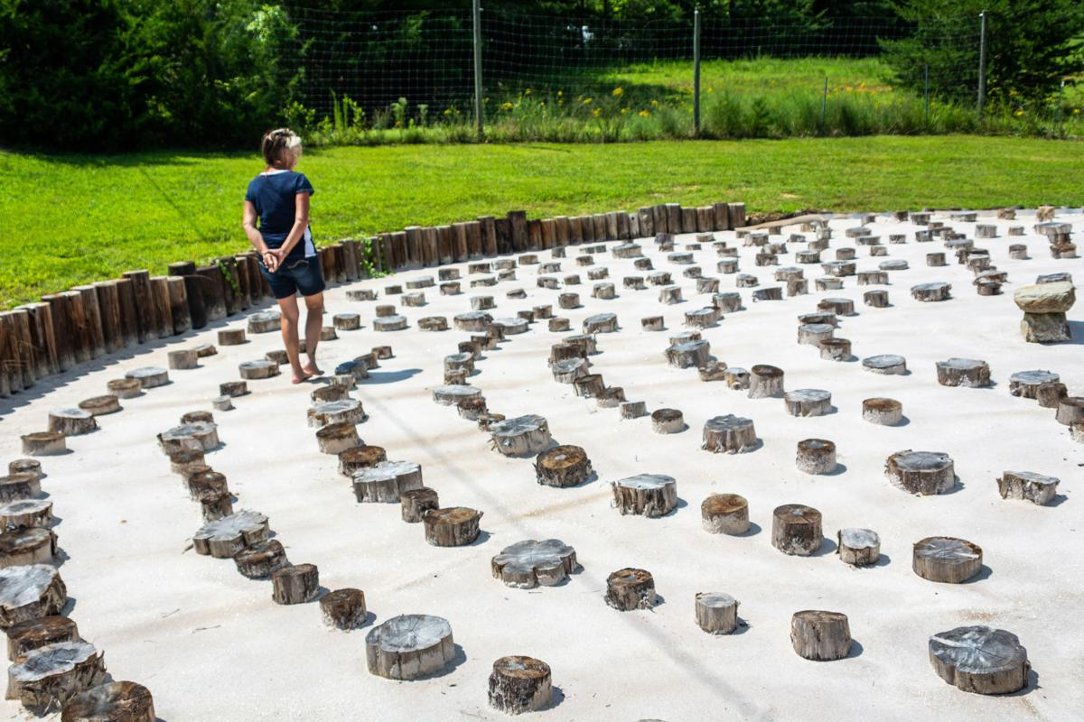 Recovering Hands founder Kim Adams walks through her home made labrynth, which is used as a calming place for meditation. Halle Parker/Register & Bee